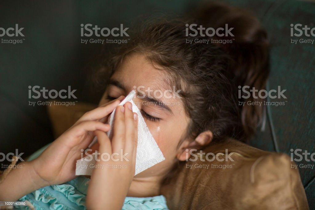 Little girl having flue or allergy