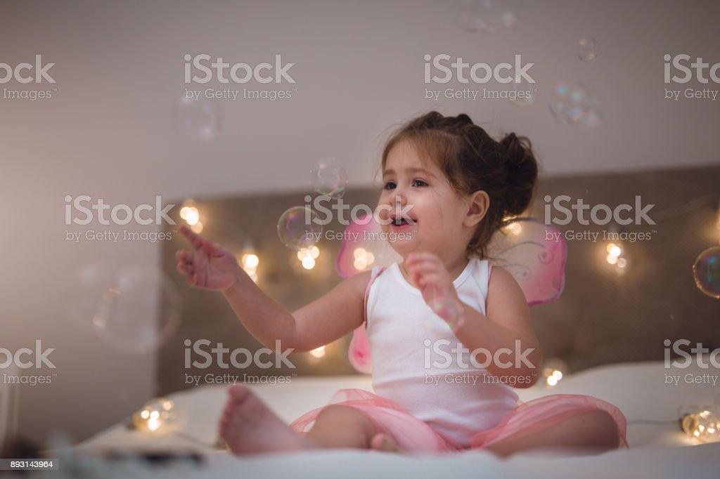 Little girl having fun at home stock photo