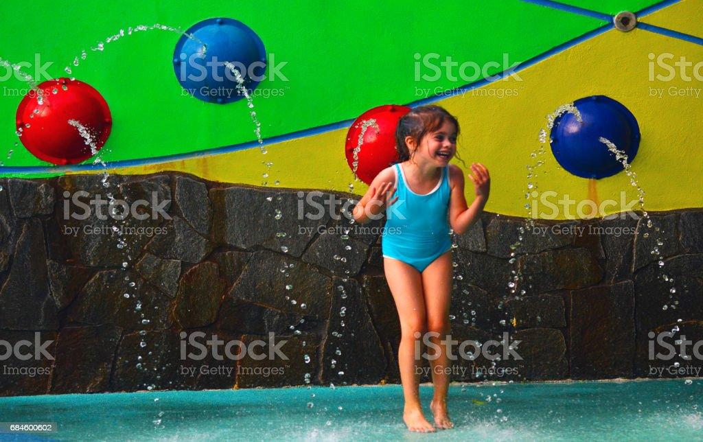Little girl having fun in Cairns Esplanade public water park in Queensland Australia stock photo