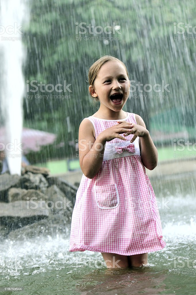 Little girl having fun in fountain royalty-free stock photo