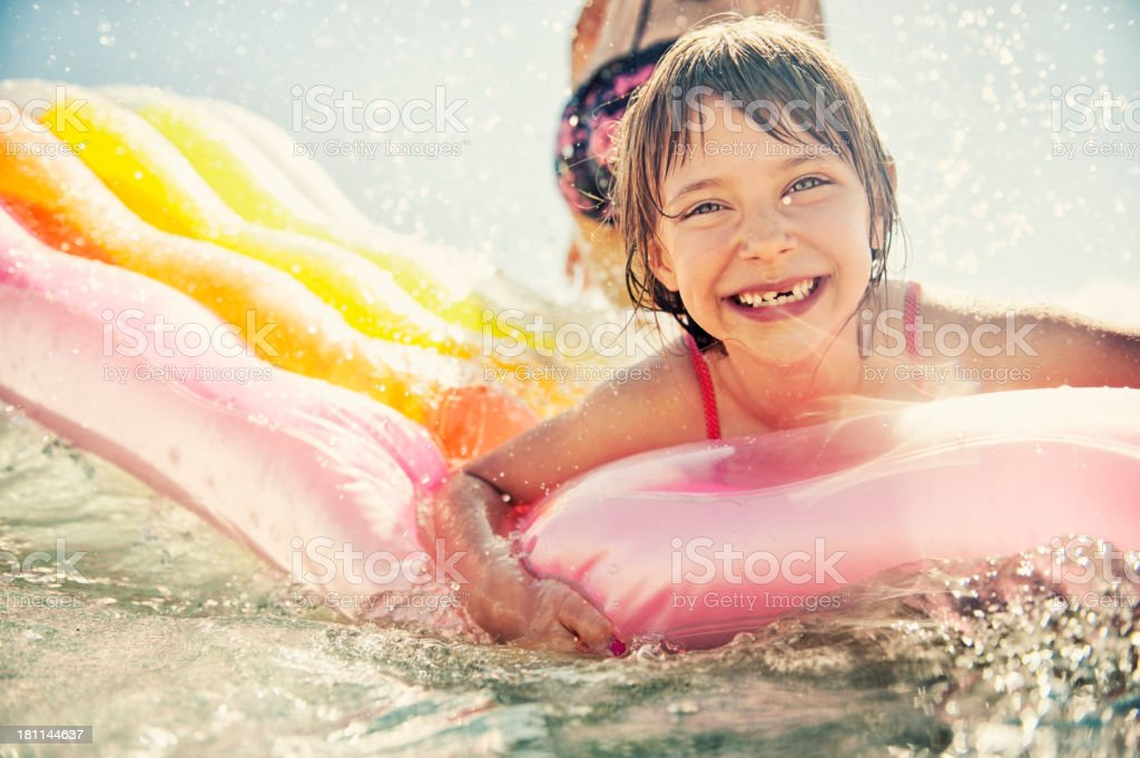 Little girl having fun in sea stock photo