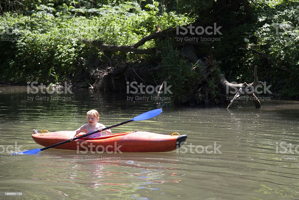 Little Girl Having Fun Kayaking royalty-free stock photo