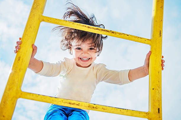 Little Girl Having Fun on a Playground stock photo