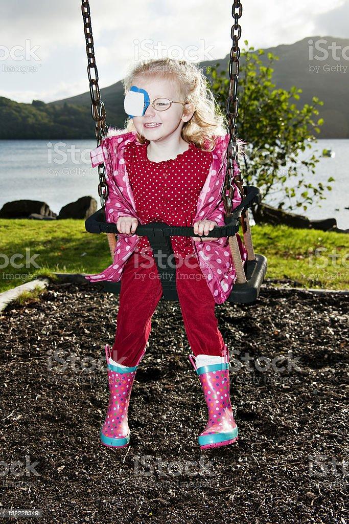 little girl having fun on a swing royalty-free stock photo