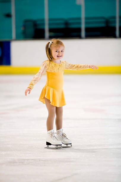 Little girl having fun on the ice stock photo