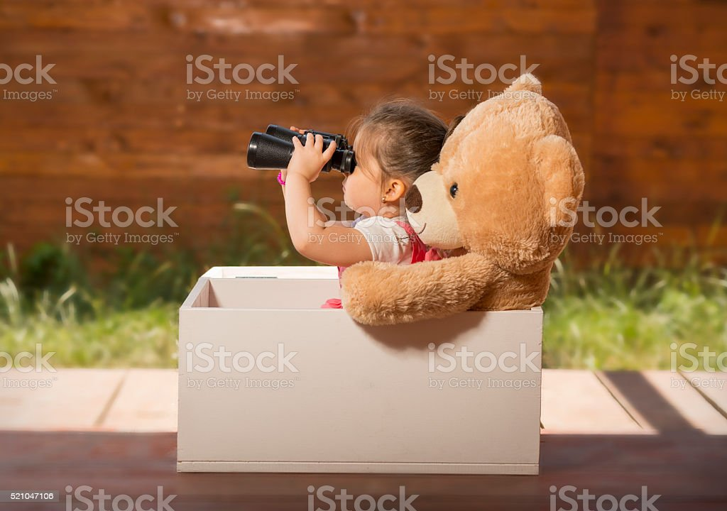 Little girl having fun playing stock photo