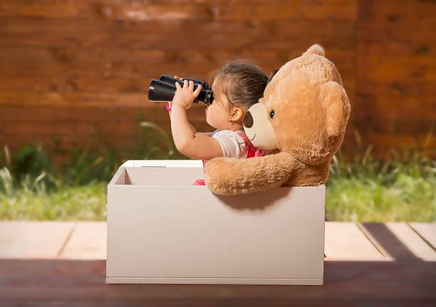 Little girl having fun playing stock photo