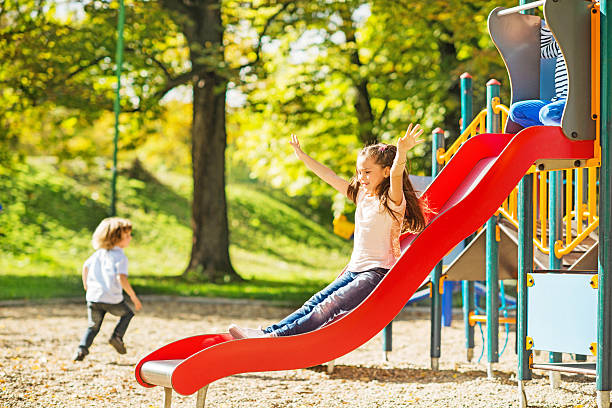 little girl having fun while sliding. - recess stock photos and pictures