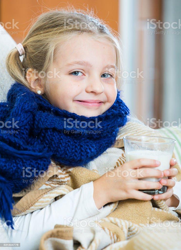 Little girl having heavy quinsy in domestic interior stock photo