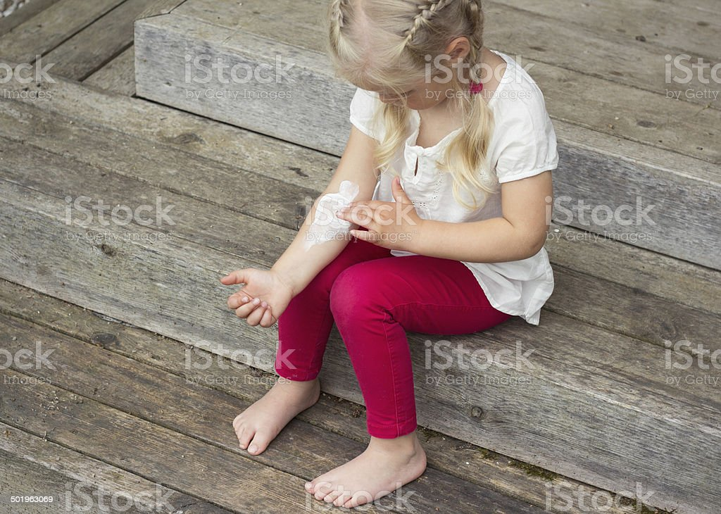 Little girl having skin problem stock photo