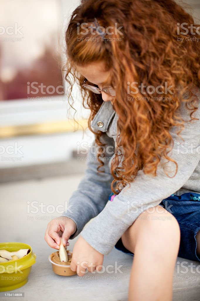 Little Girl Having Snack in the Kitchen of Her Home stock photo
