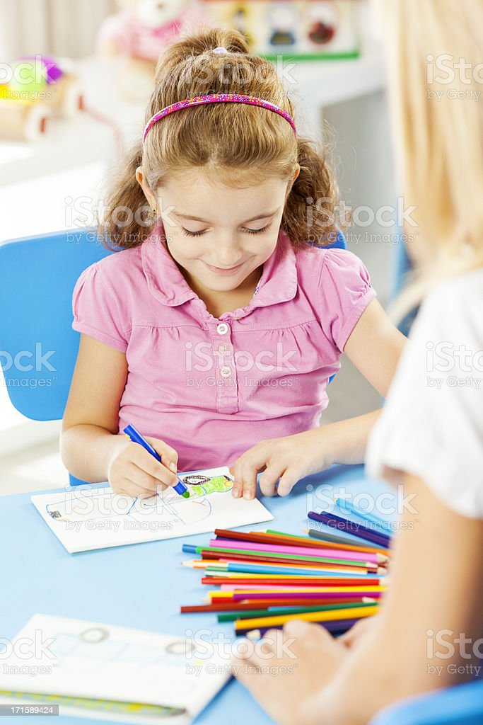 Little Girl Having Speech Therapy. stock photo