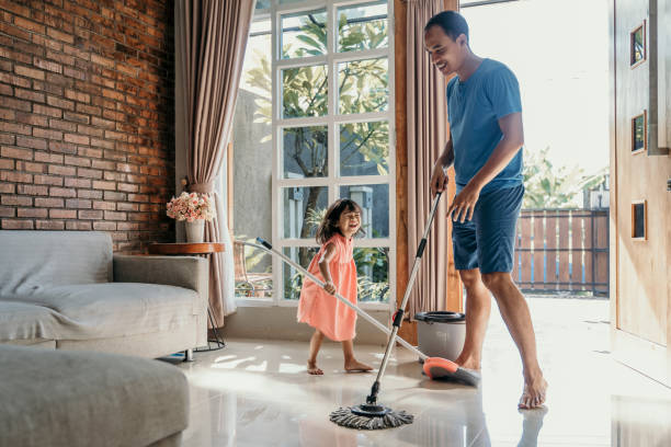 little girl help her daddy to do chores - sweeping stock pictures, royalty-free photos & images