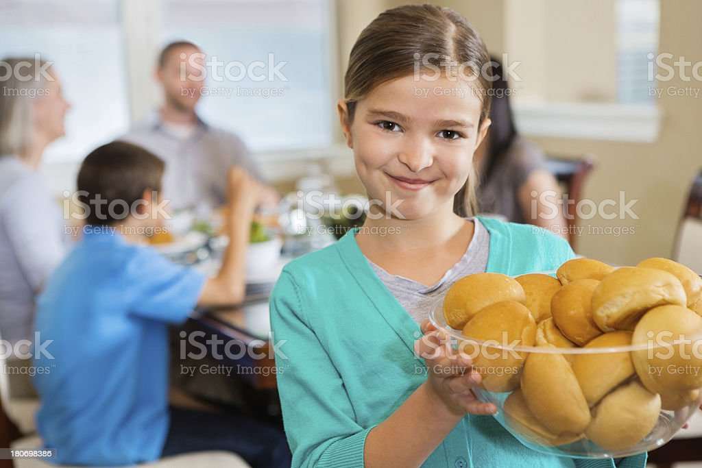 Little girl helping set dinner table for family royalty-free stock photo