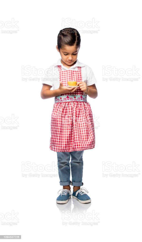 Little girl holding a cup of tea stock photo