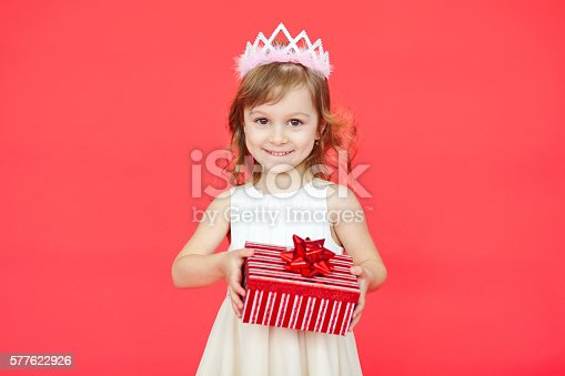 istock Little girl holding a gift box 577622926