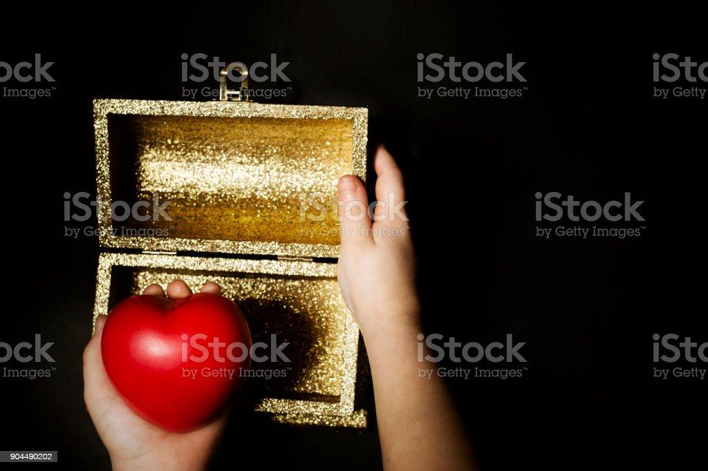 Little girl holding a heart stock photo