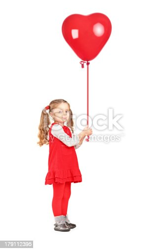 istock Little girl holding a red heart shaped balloon 179112395