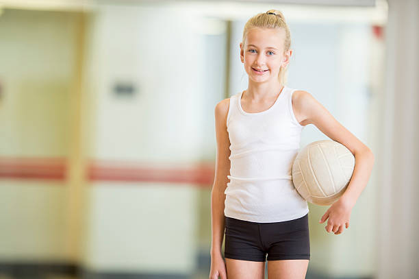 Little Girl Holding a Volleyball stock photo