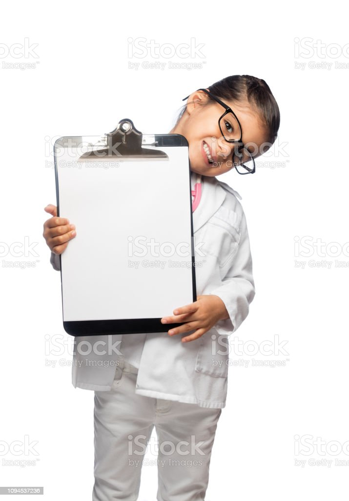 Little girl holding a white note pad stock photo