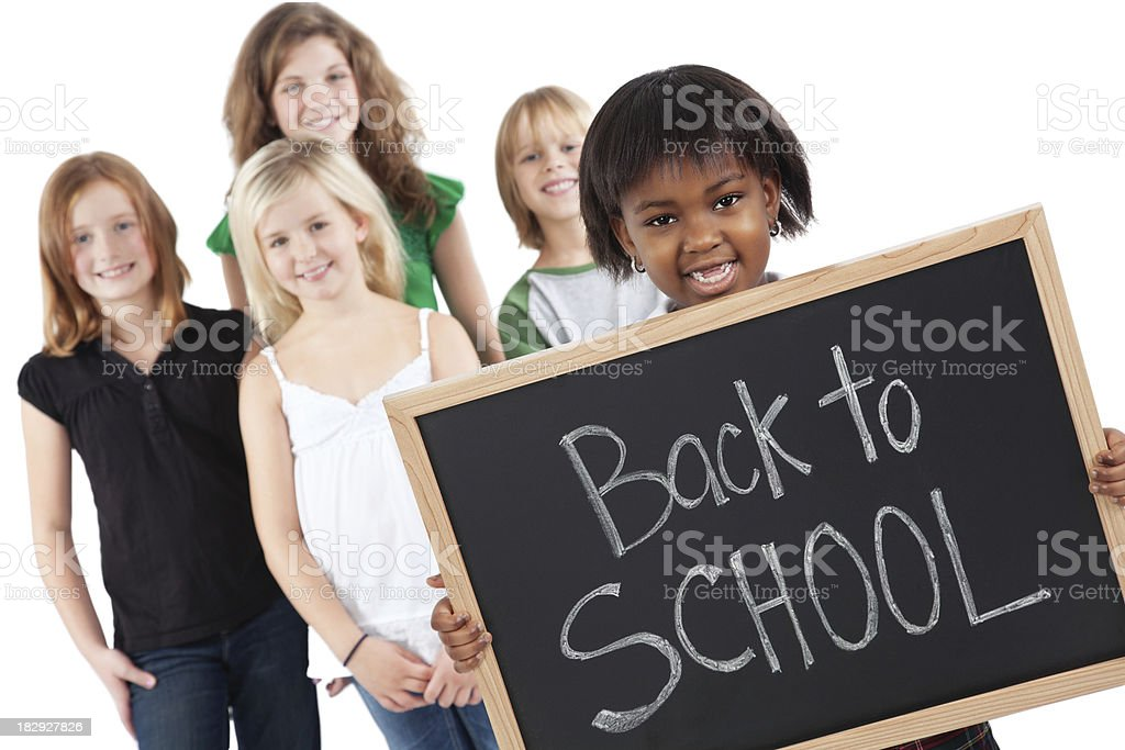 Little Girl Holding Back to School Sign With Other Students royalty-free stock photo
