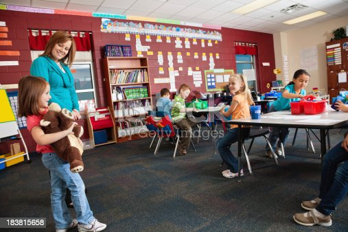639569206 istock photo Little Girl Holding Bear During Classtime Show and Tell Time 183815658
