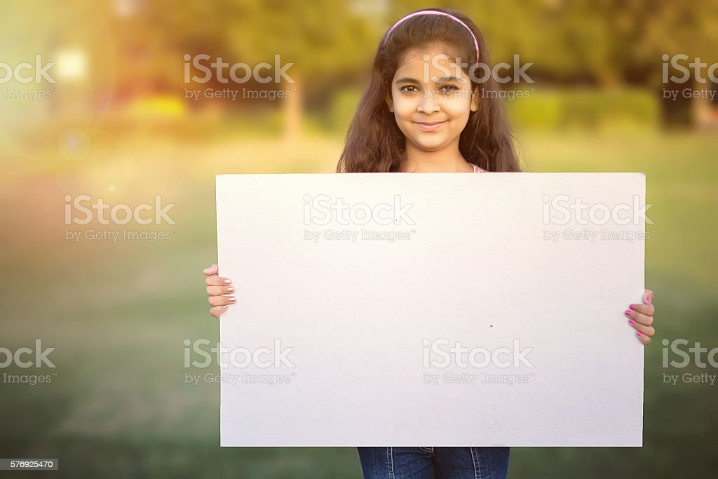 Little Girl holding blank banner stock photo