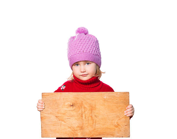 Little girl holding Board for text. stock photo