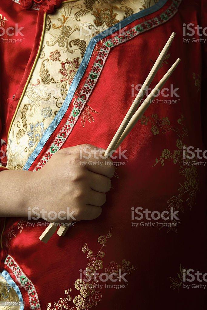 *Little Girl Holding Chopsticks royalty-free stock photo