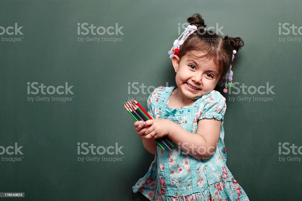 Little Girl holding colors pen royalty-free stock photo