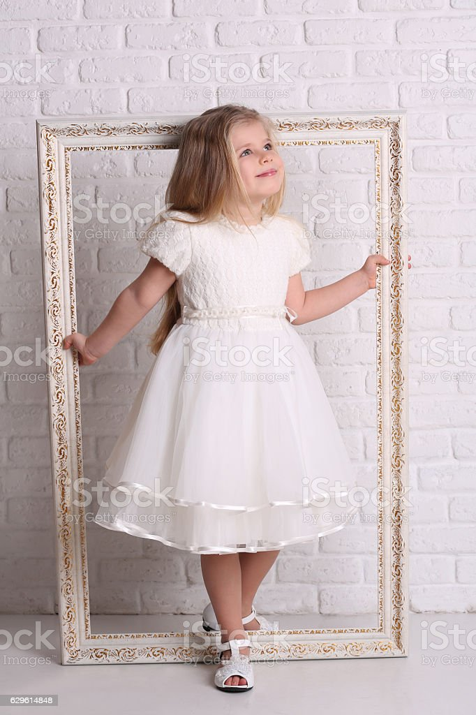 Little girl holding frame. Close up. White background stock photo
