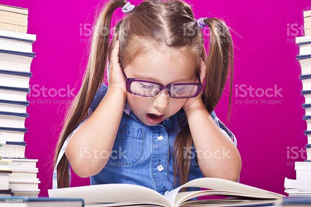 Little girl holding head royalty-free stock photo