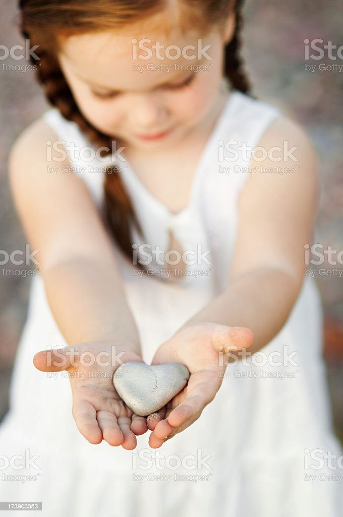 Little Girl Holding Heart-Shaped Rock royalty-free stock photo