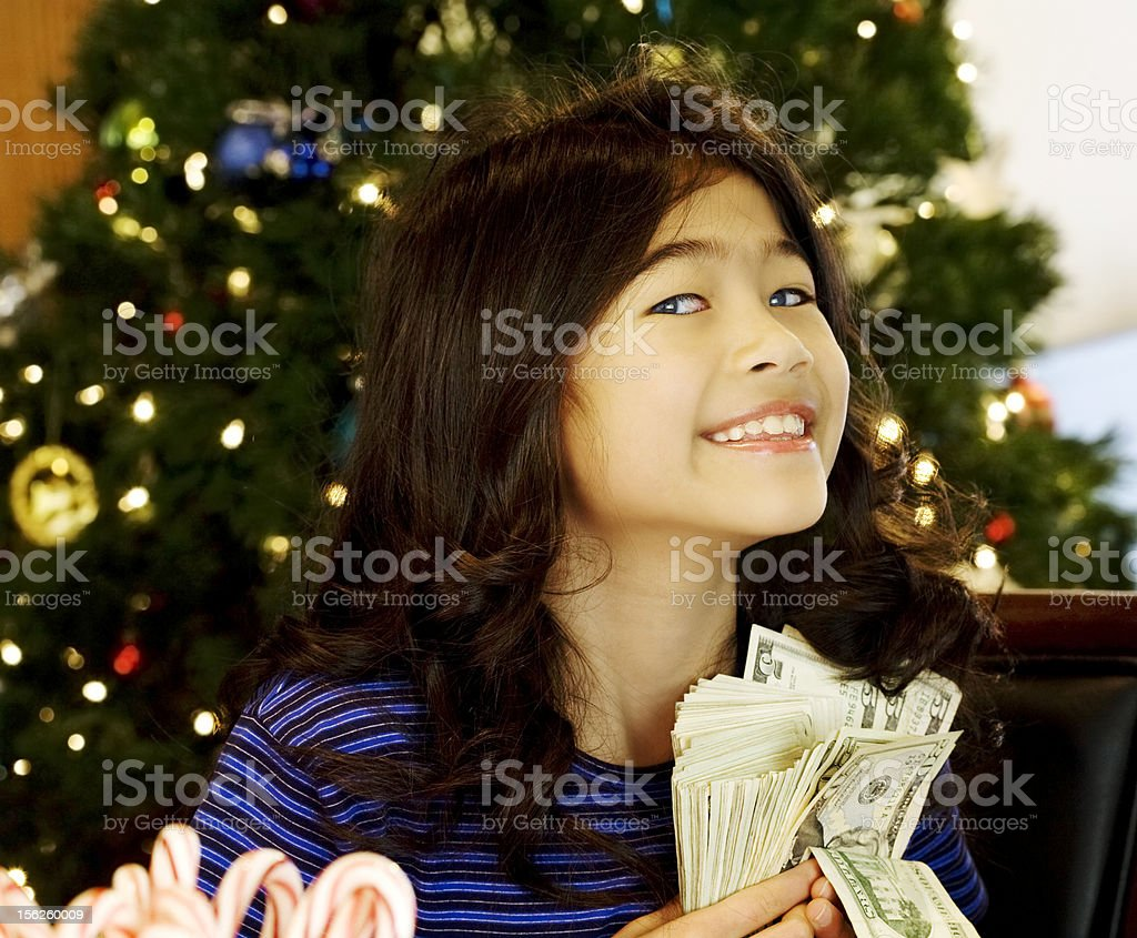 Little girl holding large wad of cash royalty-free stock photo
