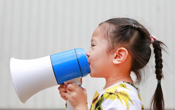 little girl holding megaphone. - loudon stock photos and pictures