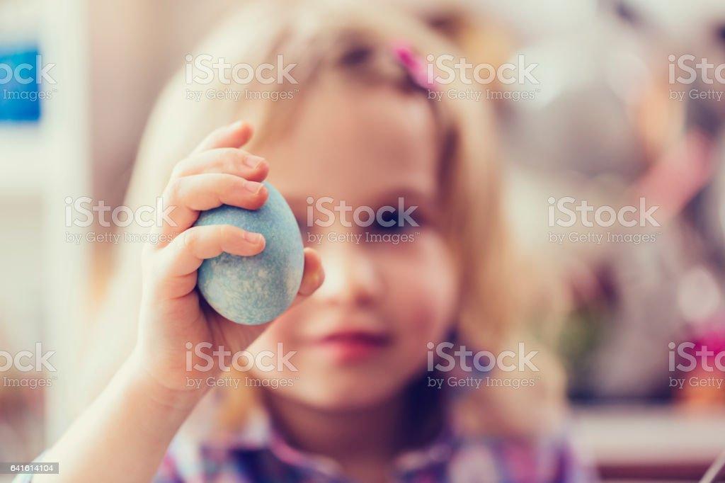 Little Girl Holding Natural Dyed Easter Egg stock photo