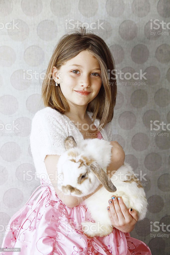 Little Girl holding Rabbit royalty-free stock photo