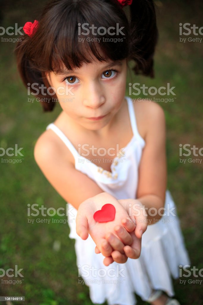 Little Girl Holding Red Heart Cut-Out royalty-free stock photo