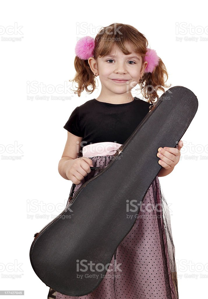 little girl holding violin case stock photo
