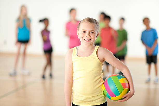 Little Girl Holding Volleyball stock photo