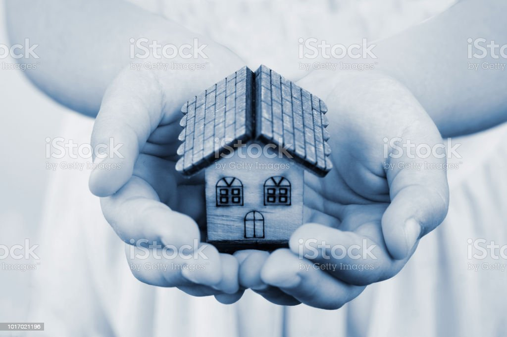 Little Girl Holds In Hands Small Toy House Stock Photo