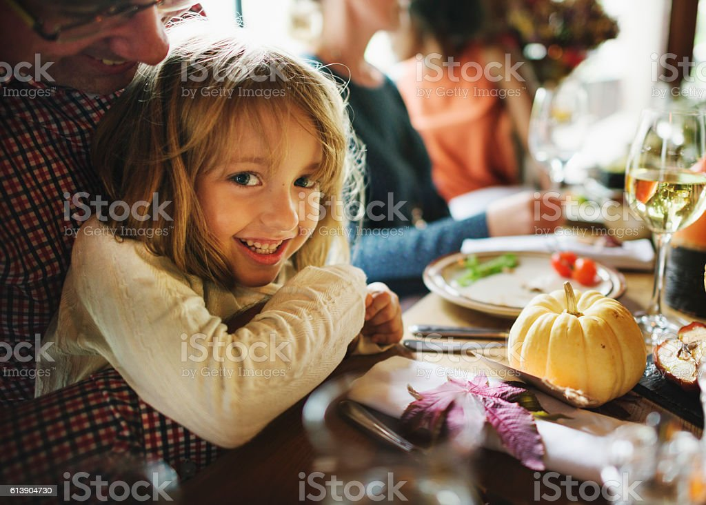 Little Girl Hugging Father Thanksgiving Celebration Concept stock photo