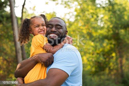 istock Little girl hugging her dad. 1075278500