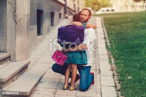 istock Little girl hugging her father before going to school 819654516