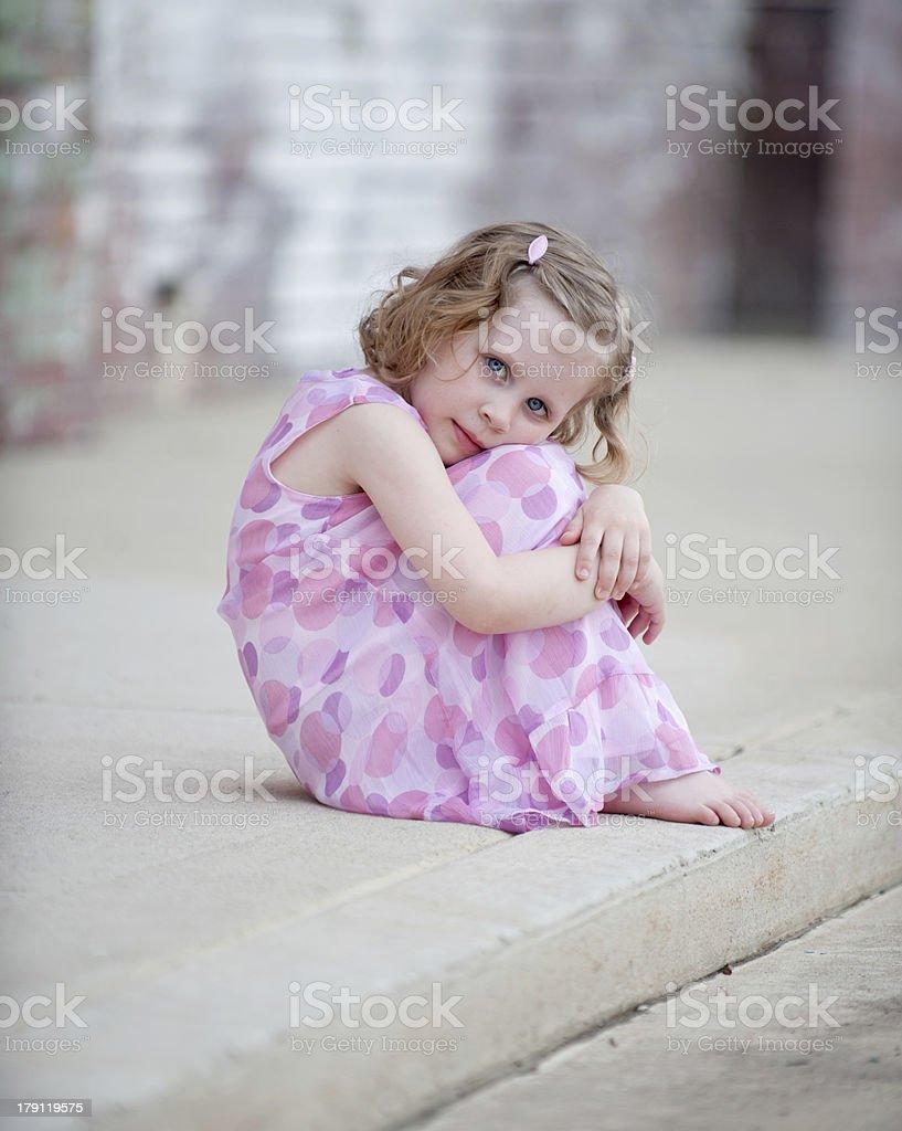 Little Girl Hugging Knees stock photo