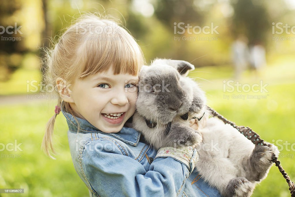 Little girl hugs a rabbit royalty-free stock photo