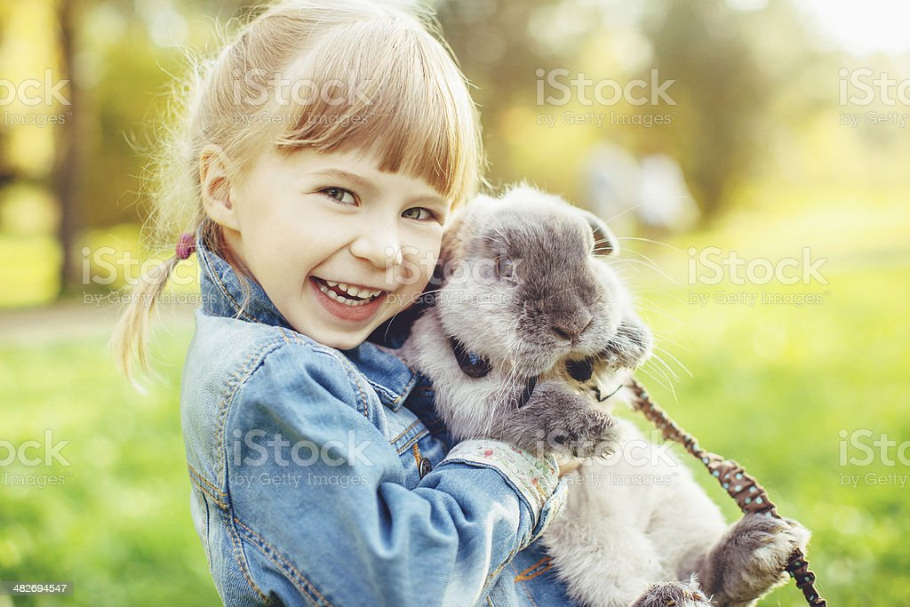 Little girl hugs a rabbit - Royalty-free Affectionate Stock Photo