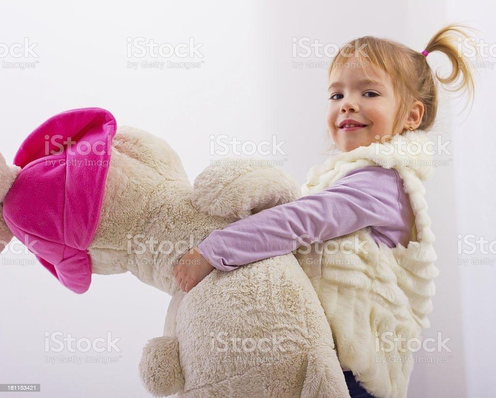 Little girl hugs her teddy bear. royalty-free stock photo