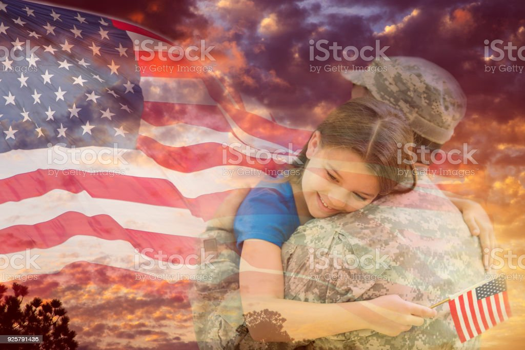 Little girl hugs military father overlay sunset, American flag. stock photo