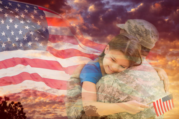 Little girl hugs military father overlay sunset, American flag. Little girl gives her military father a big hug overlay on dramatic sunset sky and waving American flag. family 4th of july stock pictures, royalty-free photos & images